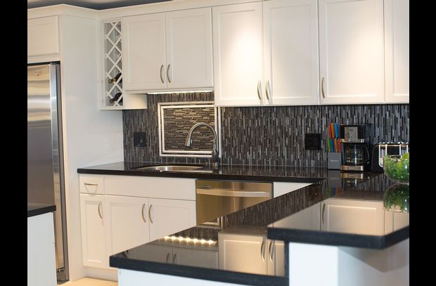 An abundance of gleaming granite for preparation and a dishwasher for clean up.